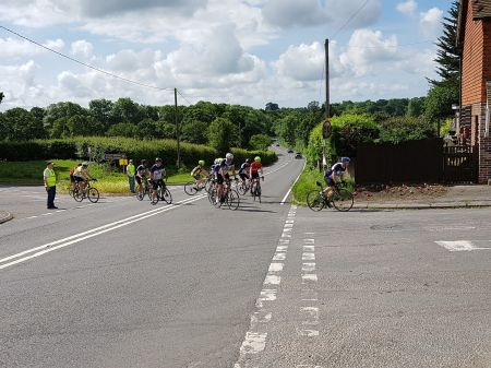 Riders crossing the A26 near Isfield