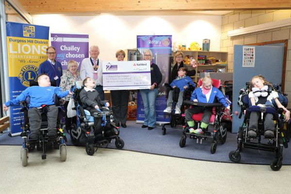 Presentation of cheque to Chailey Heritage by members of the Lions and Rotary Clubs