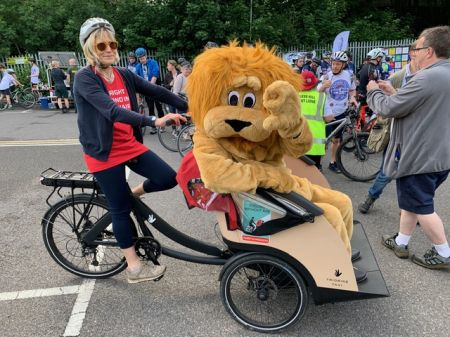 Bridget Hamilton of Cycling Without Age with the Lions mascot